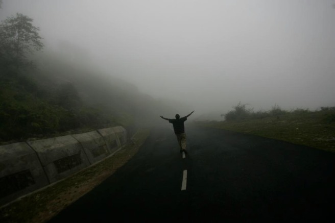 On the road to Cherrpunjee, a young man embraces the fog.